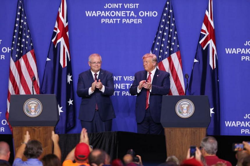 US President Donald Trump (right) and Australian Prime Minster Scott Morrison clap during an event at Pratt Industries in Wapakoneta, Ohio on Sept 22, 2019.