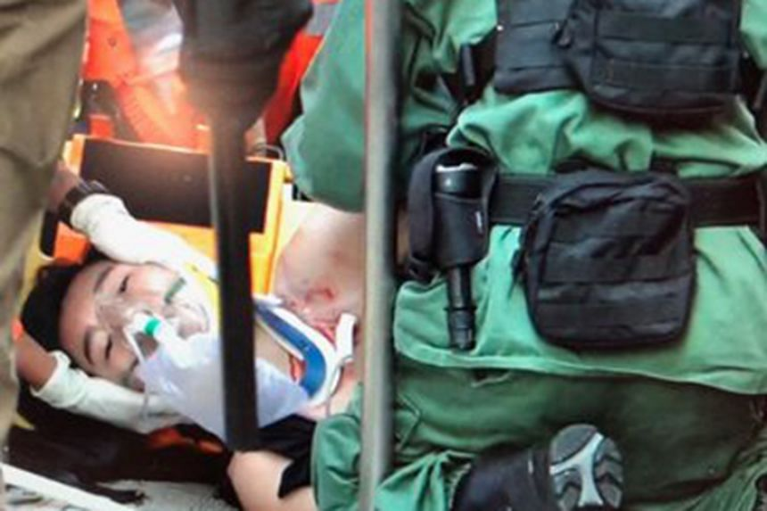 TV footage showed medical personnel attending to the man in Tai Ha Road.