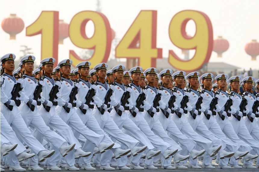 Soldiers marching on Tiananmen Square during a rehearsal before a military parade taking place as part of China's 70th anniversary celebrations, on Oct 1, 2019.