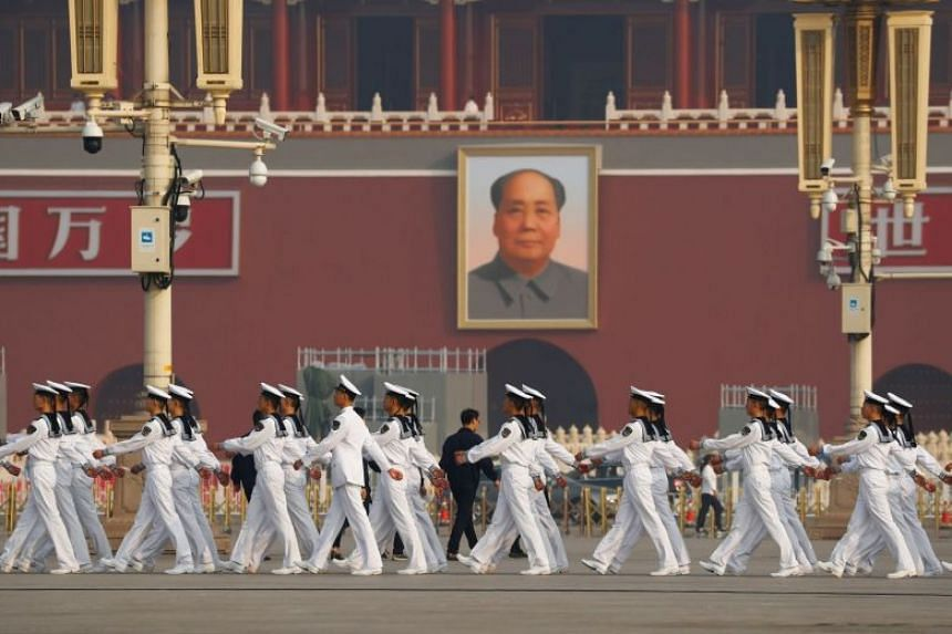 Soldiers march in Tiananmen Square before a ceremony marking the 70th anniversary of the founding of the People's Republic of China in Beijing on Sept 30, 2019.