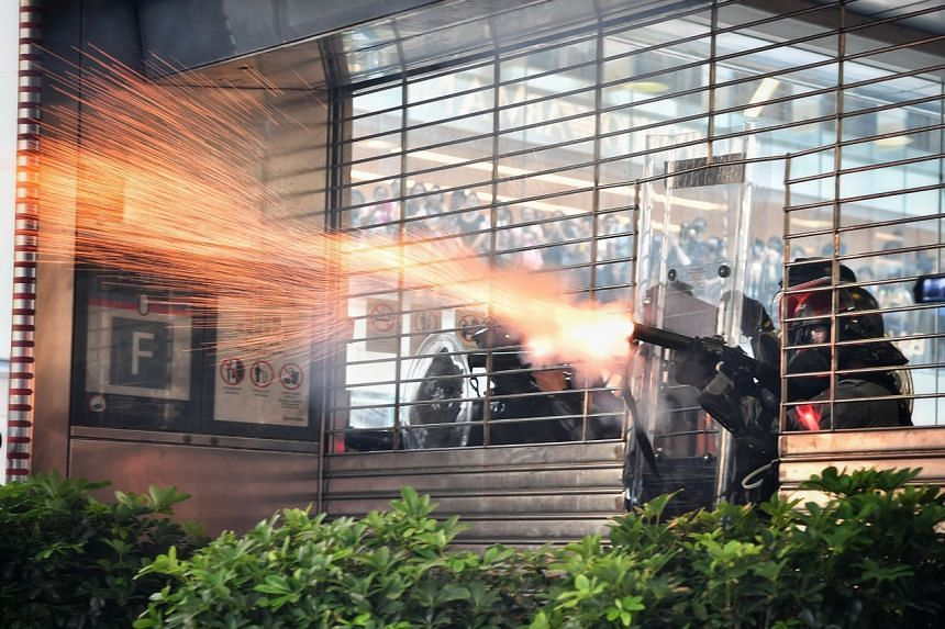Hong Kong police fire tear gas from inside Central MTR station on Oct 1, 2019.