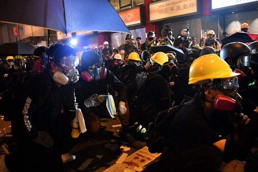 Protesters armed with petrol bombs in Hong Kong's Wan Chai district on Oct 1, 2019.