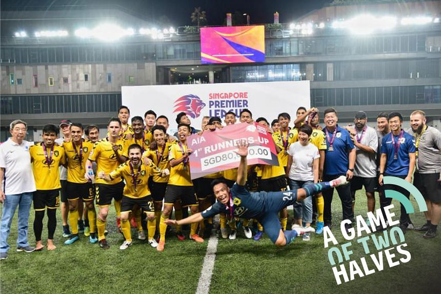 Tampines Rovers celebrating with the mock cheque of $80,000 for finishing second, after the 1-1 draw with the Young Lions last night at Our Tampines Hub.