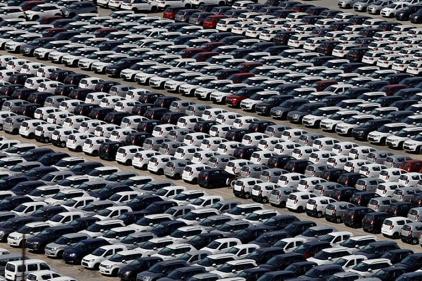 Cars are seen parked at Maruti Suzuki's plant in Manesar, Haryana, India, on Aug 11, 2019. Auto manufacturers in India say they are experiencing the worst downturn in 25 years.