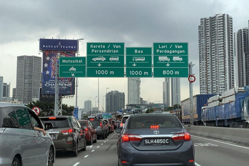 Malaysia's Vehicle Entry Permit enforcement was scheduled to begin on Oct 1, with the scheme conducted only during non-peak hours.
