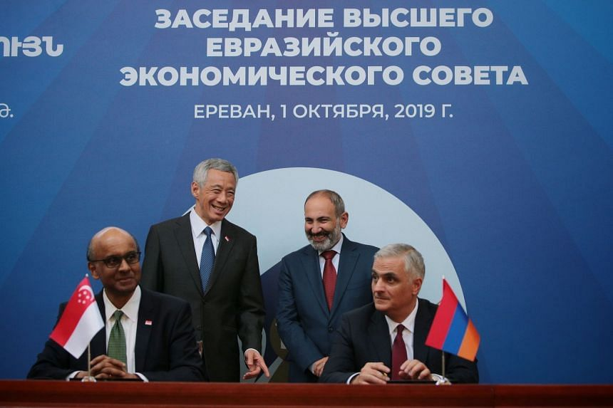 Prime Minister Lee Hsien Loong and his Armenian counterpart Nikol Pashinyan witnessing Senior Minister and Coordinating Minister for Social Policies Tharman Shanmugaratnam and Armenia's Deputy Prome Minister Mher Grigoryan signing a services and in