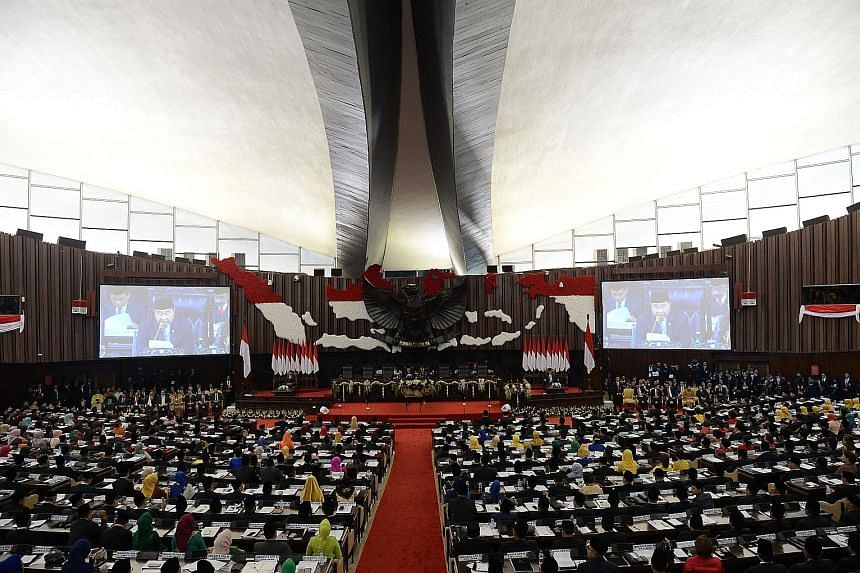 New Indonesia Parliament members take oath amid protests