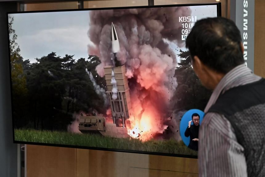 A man watches file footage of a North Korean missile launch, at a railway station in Seoul, on Sept 10, 2019.