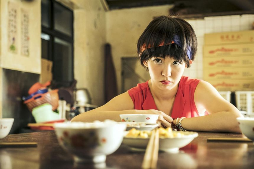 Still from The Teenage Psychic starring Kuo Shu-yao. In the series, her character Xiao Zhen juggles high school life with her spiritual duties in a temple as a psychic who helps grieving people talk to the dead.