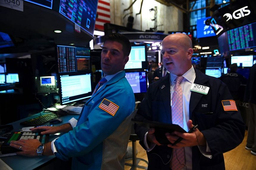 Traders work at the New York Stock Exchange on Sept 27, 2019.