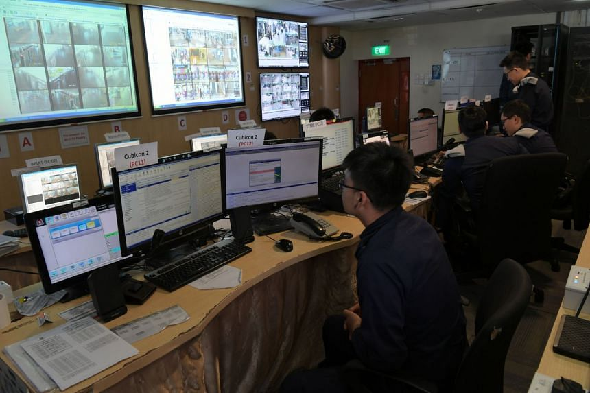 "The operation room of Transcom with officers manning the security of MRT stations and bus interchanges through CCTVs. Singapore is working towards having the systems used for video analytics across Singapore standardised, and made more ""intelligent""."
