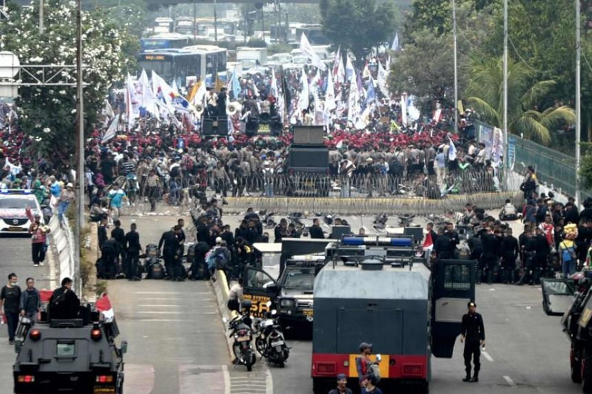 Labourers calling for a living wage take part in a rally outside the Parliament in Jakarta on Oct 2, 2019.