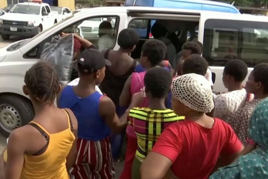 A still image from video shows women freed by the police entering a bus in Lagos.