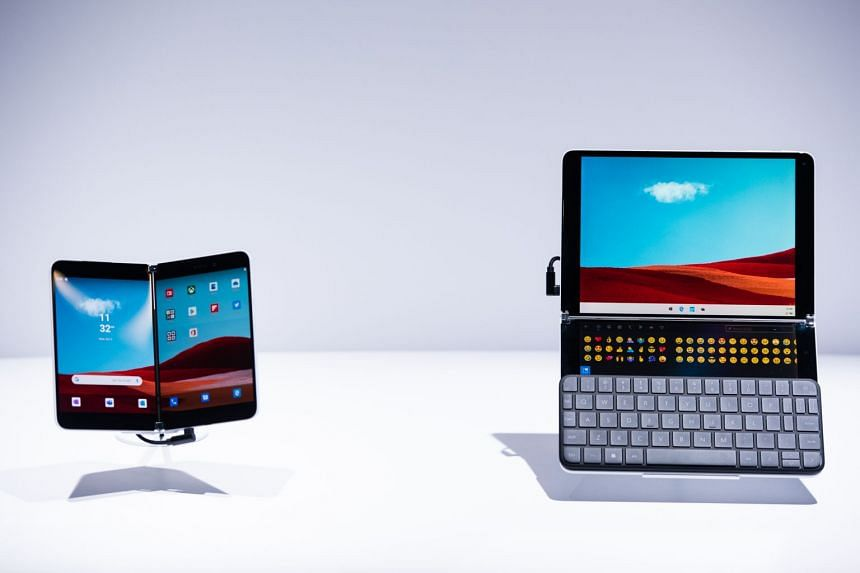 Microsoft's Surface Duo smartphone (left) and Surface Neo laptop computer are displayed during a product event in New York.