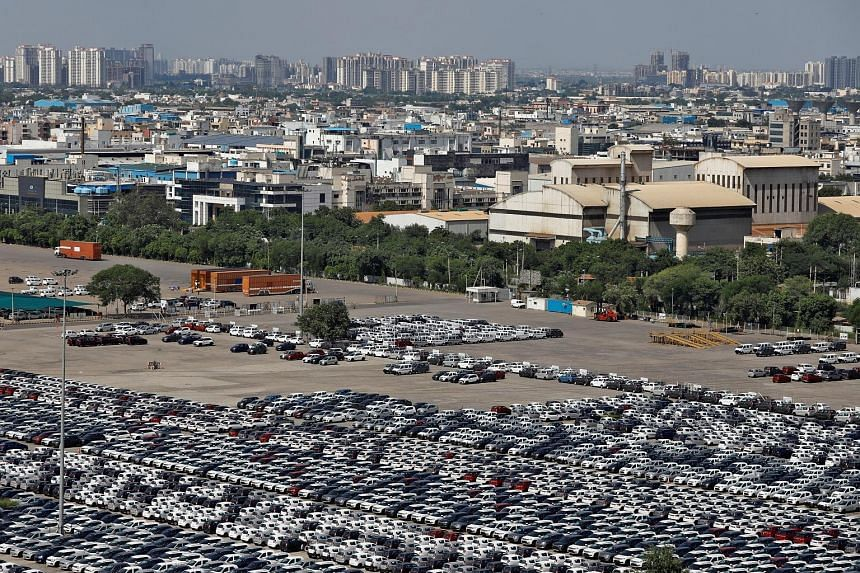 Cars parked at Maruti Suzuki's plant in Manesar, in the northern state of Haryana on Aug 11. The carmaker, which has the biggest market share in India, suffered a whopping 34 per cent drop in sales in August.