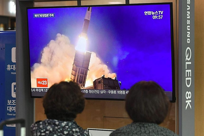 People in Seoul watching file footage yesterday of a North Korean missile launch the same day the North fired what appeared to be a submarine-launched ballistic missile. Under United Nations Security Council regulations North Korea is banned from