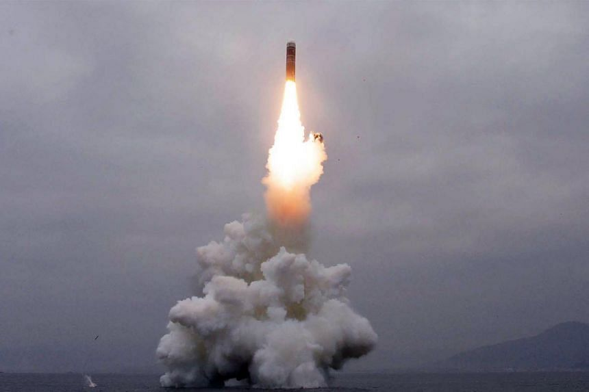 """In this photo taken on the morning of Oct 2, 2019, and released by KCNA, shows the test-firing of """"the new-type SLBM Pukguksong-3"""" in the waters off Wonsan Bay of the East Sea of Korea."""