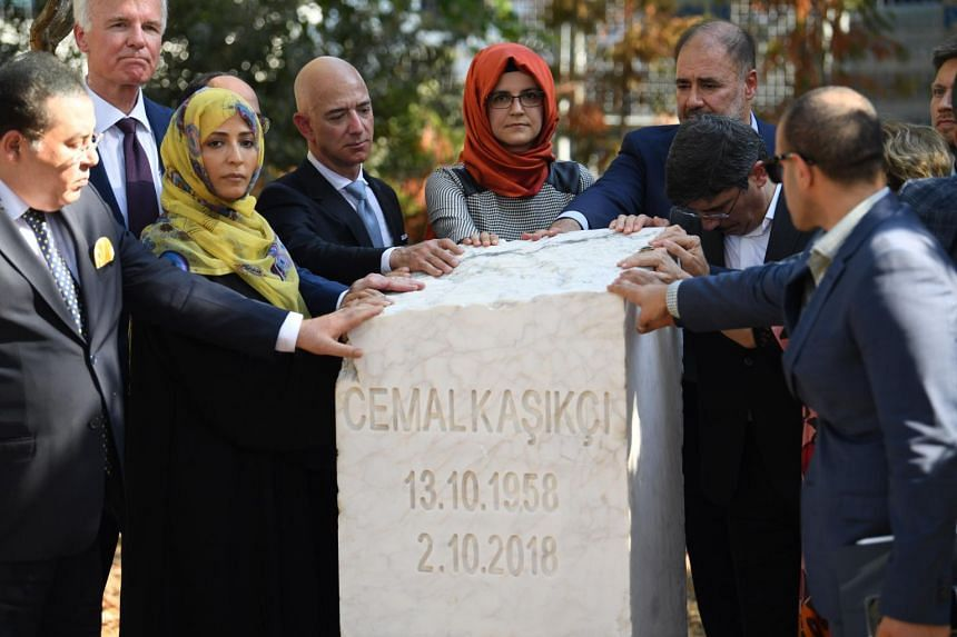 Ms Hatice Cengiz (centre) and Mr Jeff Bezos (on her right) stand at the memorial stone during an event marking the one-year anniversary of journalist Jamal Khashoggi's assassination, in Istanbul, on Oct 2, 2019.