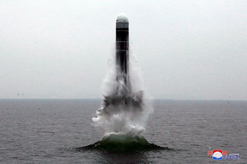 A photo released by a North Korean media outlet showing what appears to be a submarine-launched ballistic missile being fired at an undisclosed location, on Oct 2, 2019.