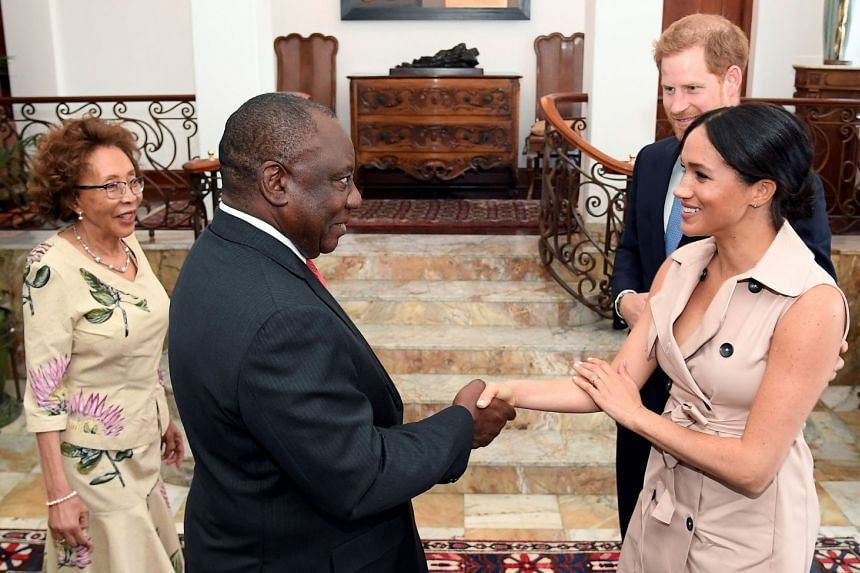 South African President Cyril Ramaphosa (second left) and his wife Tshepo Motsepe (left) receive Prince Harry and his wife Meghan.