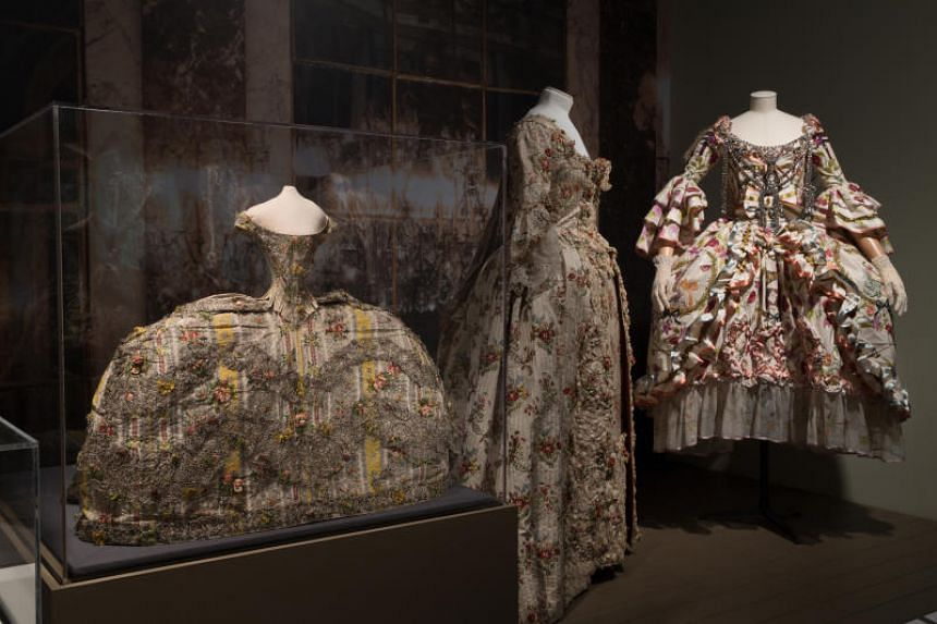 (From left) Two dresses from about 1755-1760 and a fall 2000 haute couture design by John Galliano for Christian Dior with an underskirt and a metal frontpiece, at The Museum at FIT in New York.