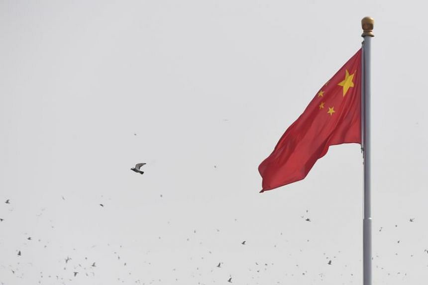 Doves fly past the national flag in Tiananmen Square during the National Day parade in Beijing on Oct 1, 2019, to mark the 70th anniversary of the founding of the People's Republic of China.