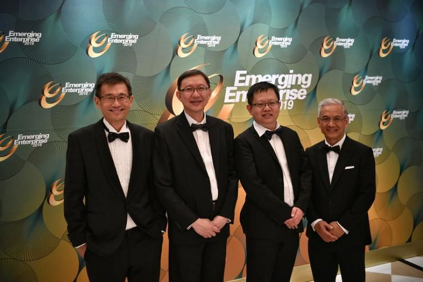 Winners of the Emerging Enterprise Award (from left) Mr Wong Joo Seng, co-founder and CEO of Spark System, Mr Jeremy Heng and Mr Ethan Chu, two of the three co-founders of Xjera Lab and Mr Charles Cher, Chairman of Emage Vision at the awards night on