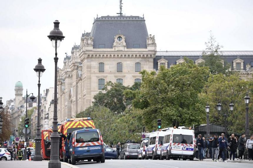 The area around the police headquarters, which is close to Notre-Dame Cathedral, was cordoned off around lunchtime, and emergency services were at the scene on Oct 3.