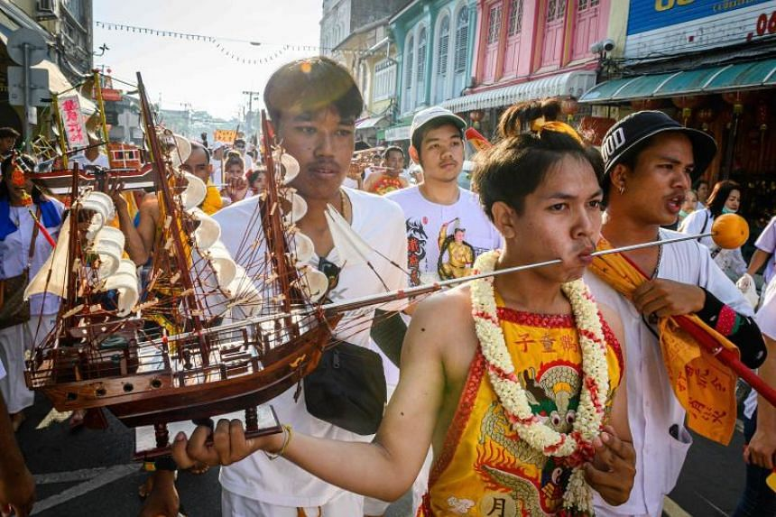 As firecrackers exploded and traditional music blared from speakers, hundreds of participants marched down streets showcasing a dizzying variety of piercings.