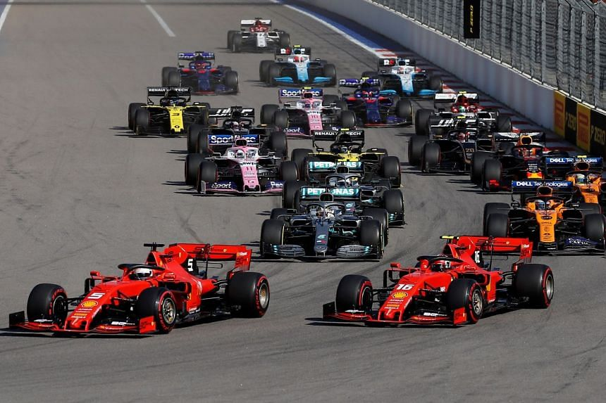 Ferrari's Sebastian Vettel leads Ferrari's Charles Leclerc and Mercedes' Lewis Hamilton at the first corner of the Russian grand prix.