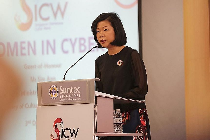 Senior Minister of State for Communications and Information Sim Ann addressing the audience at the Women In Cyber event yesterday. ST PHOTO: GIN TAY