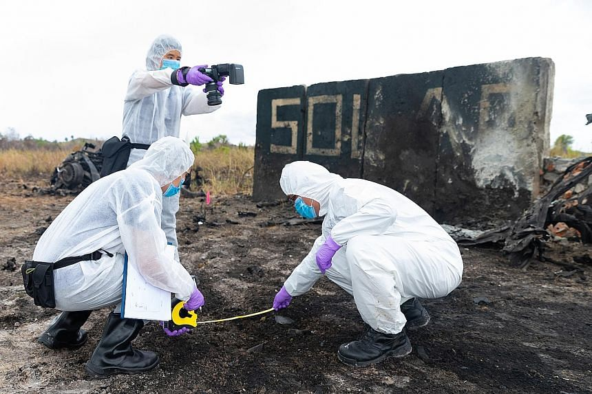 """Singapore and Bruneian investigators processing evidence at a """"bomb site"""" during their Solar Wind exercise in Brunei this week. Unlike previous iterations, this year's exercise featured multiple bomb attacks at different locations. PHOTO: SINGAPORE P"""