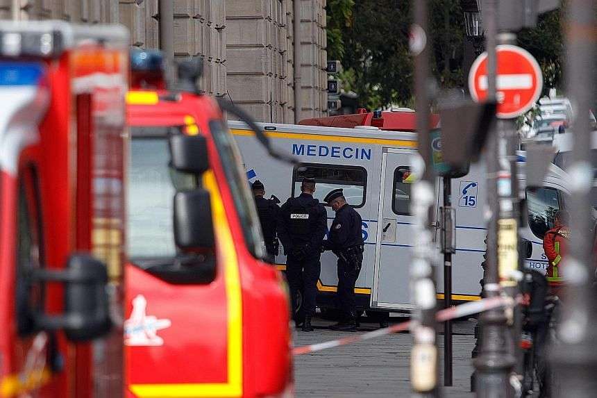 The Paris police headquarters and surrounding premises were cordoned off yesterday after a man stabbed to death four officers before he was shot dead by police. PHOTO: AGENCE FRANCE-PRESSE