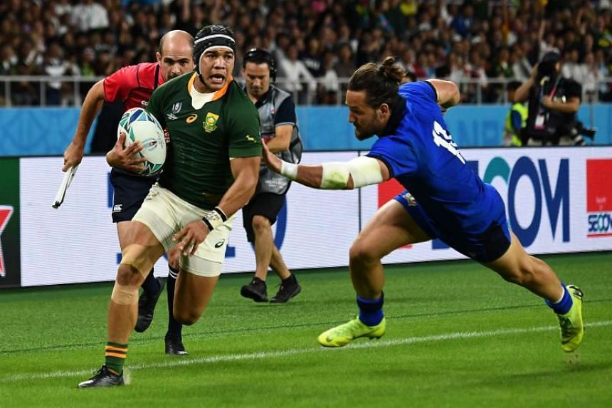 South Africa's Cheslin Kolbe runs to score a try during the Rugby World Cup Pool B match against Italy at the Shizuoka Stadium Ecopa in Shizuoka, Japan, on Oct 4, 2019.