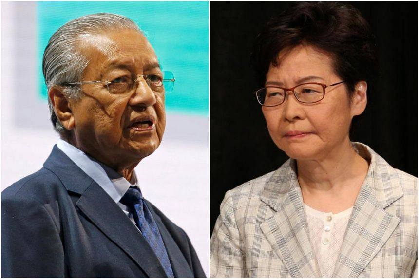 """Malaysian Prime Minister Mahathir Mohamad said that Hong Kong leader Carrie Lam """"is in a dilemma, she has to obey the masters (but) at the same time, she has to ask her conscience""""."""