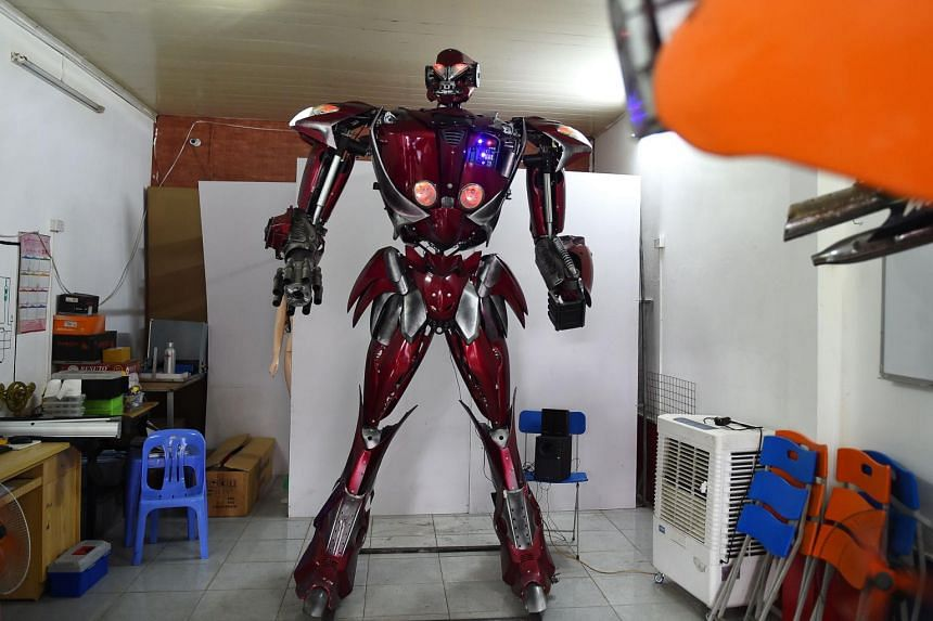 The 100kg and 3m high Robot One is made from motorcycle parts. It is controlled by a PlayStation joystick, can make simple moves and utter some basic phrases.