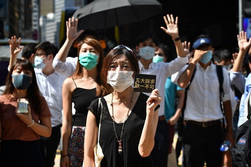 Protesters marching against a ban on face masks in Hong Kong's Central district on Oct 4, 2019.