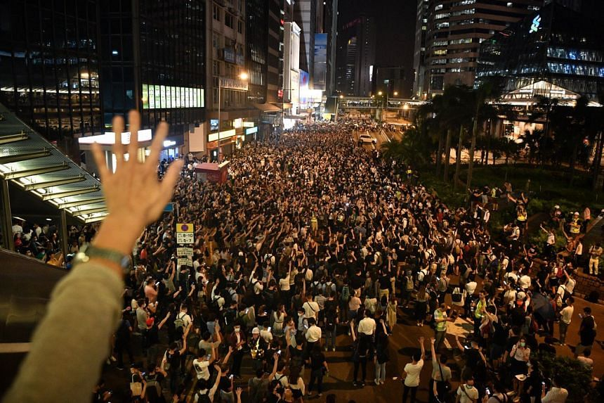 Protesters marching in Hong Kong's Central district on Oct 4, 2019.