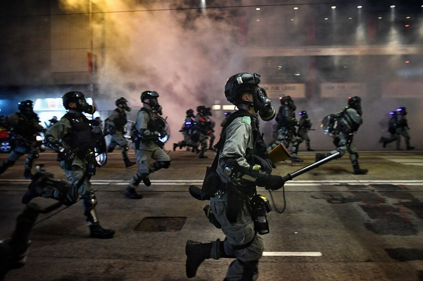 Police chasing protesters in Hong Kong's Causeway Bay on Oct 4, 2019.