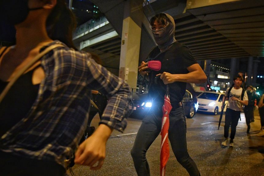 Protesters running from the police in Admiralty in Hong Kong on Oct 4, 2019.