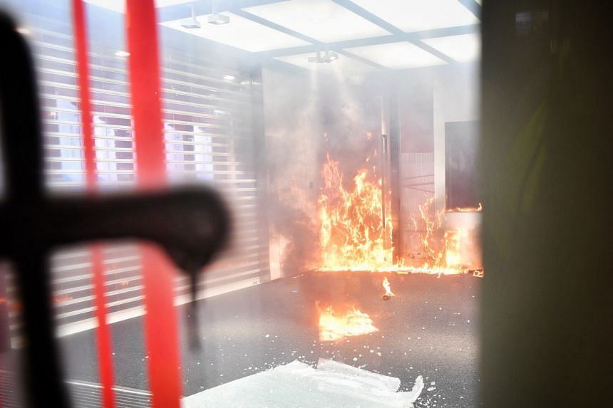 Fire inside a Bank of China branch in Causeway Bay in Hong Kong on Oct 4, 2019.