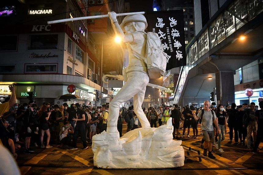 Protesters with the Statue of Liberty to Causeway Bay in Hong Kong on Oct 4, 2019.
