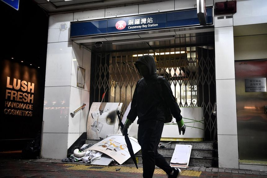 A protester walks off after trashing the exit of Causeway Bay MTR station on Oct 4, 2019.