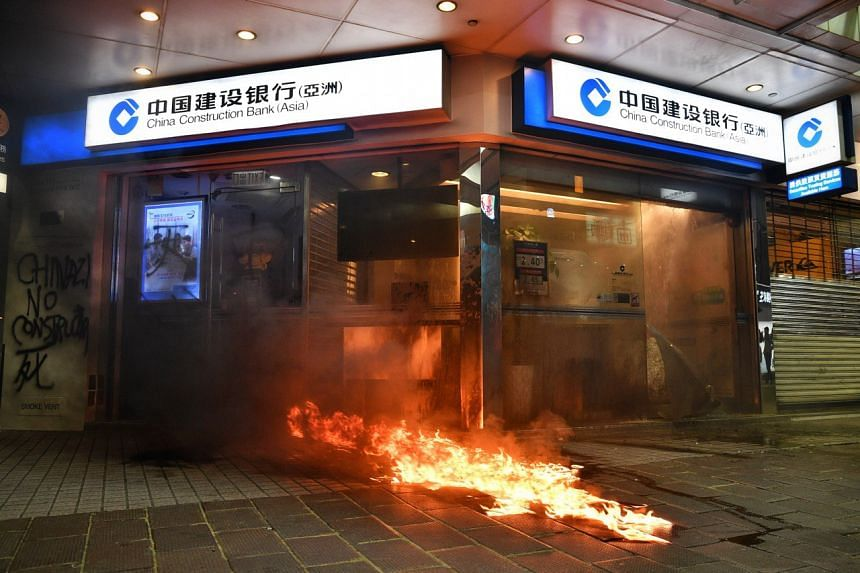 Protesters set fire to a China Construction Bank branch in Causeway Bay in Hong Kong on Oct 4, 2019.
