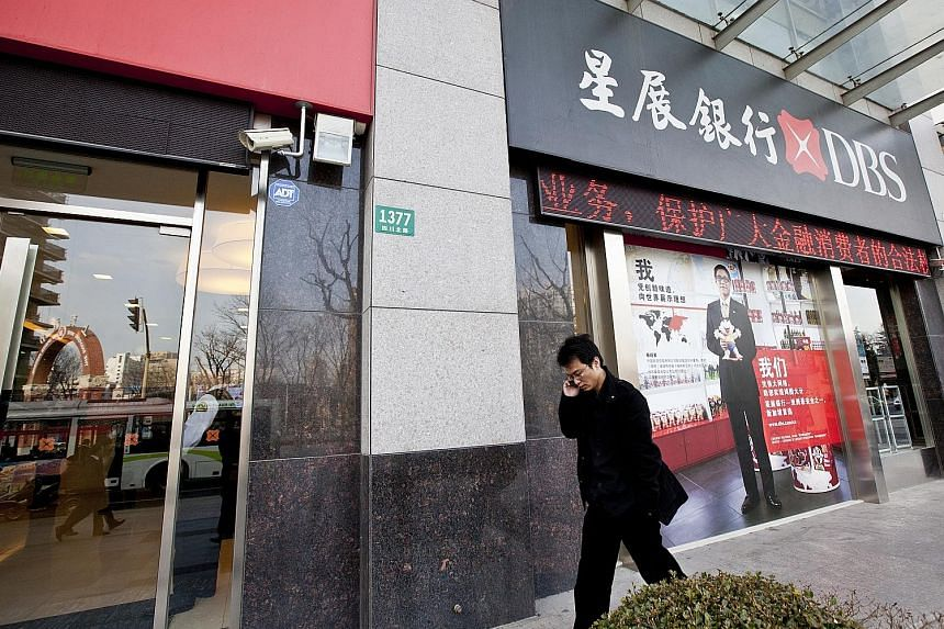 DBS Bank's branch in Chongqing, China. Tech companies want to deal with banks that can wrap their traditional offering of cash management with services that are important to end-customers, such as simple user interfaces, says the writer. PHOTO: DBS