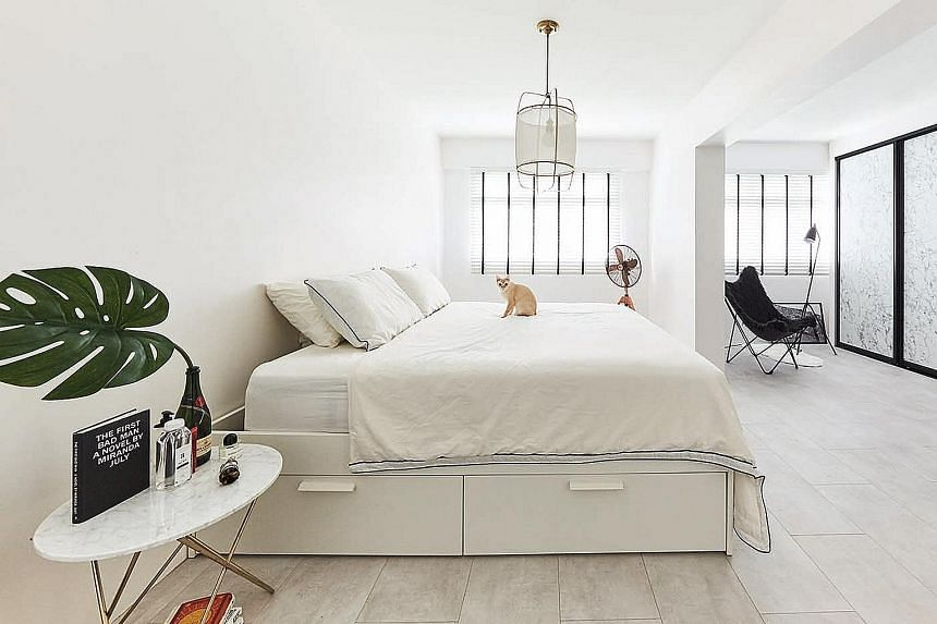 The all-white palette in the bedroom creates a restful yet elegant ambience.