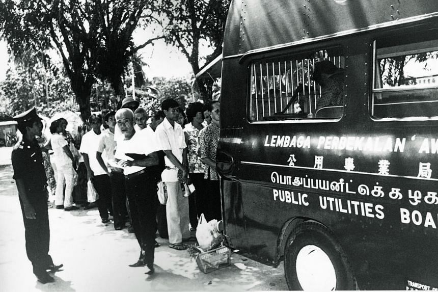 A mobile collection unit from the then Public Utilities Board collecting payment from rural customers in the 1960s for the use of electricity. The PUB's rural electrification programme in the 1960s and 1970s aimed to connect every kampung in Singapor