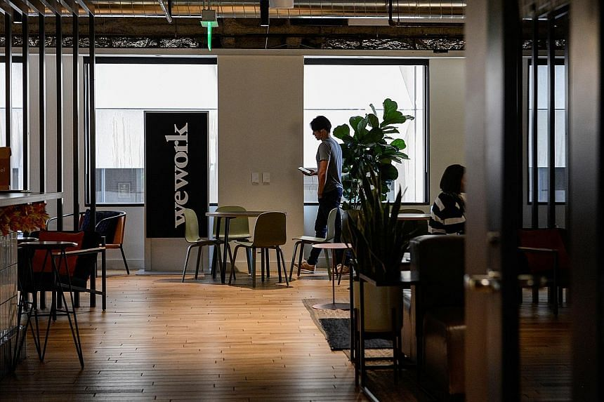 """According to those who attended the staff meeting, executives said they expect WeWork to continue to grow but at a slower pace, and that the company planned to make some divestitures as part of an effort to """"right-size"""" its business."""