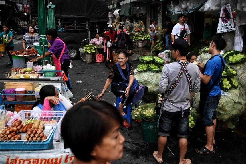A fresh produce and flower market in Bangkok. The Thai baht is the world's top performer against the dollar over five years, hurting export competitiveness and putting the economy on course for the weakest growth since 2014.