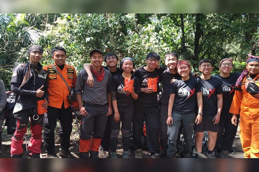 The hikers were part of a group of 13 who were trapped on the volcano after forest fires broke out.